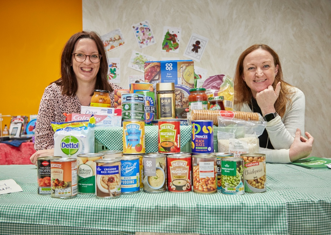East Yorkshire Food Bank Chair Kate Leaf with Beverley Building Society's Tracy Fletcher