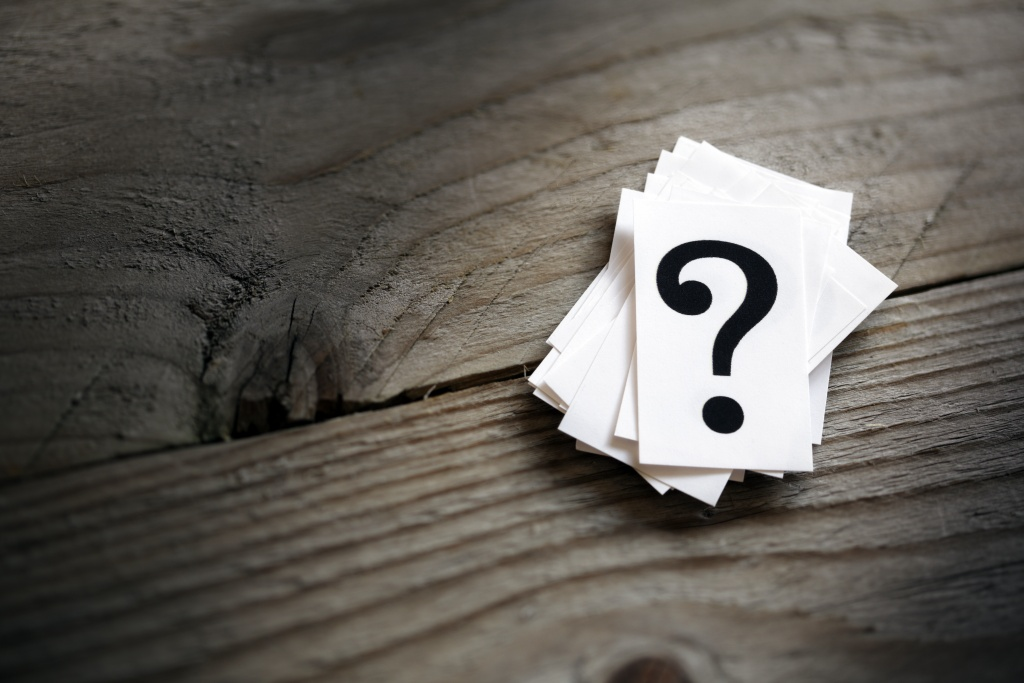 Question mark on a table - concept illustrating encouraging readers to ask questions